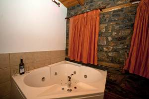 Palaios Agios Athanasios suites fireplace jacuzzi